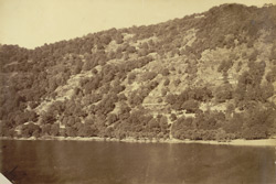 View of the lake, Naini Tal, showing bungalows scattered on the eastern hills